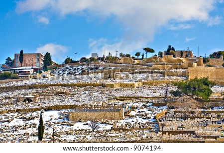Old cemetery covered with rare snow (Jerusalem, Mt. Olives) - stock photo