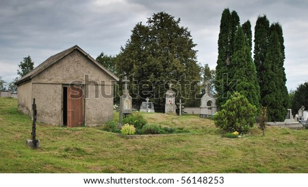 Old cemetery in cloudy and rainy day - stock photo
