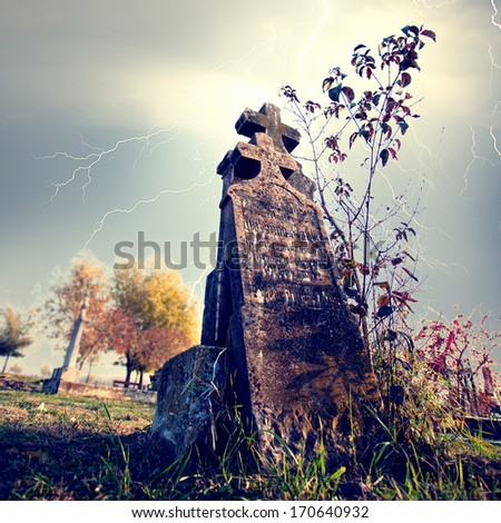 Old cemetery with ligthning bolt - stock photo