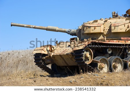 Old centurion tank of the yom kippur war close to the syrian border on the Golan Heights in Israel - stock photo