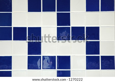 Old ceramic tile in blue and white - stock photo