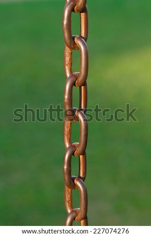 Old chain on green background - stock photo