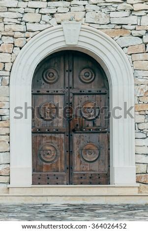 Old chapel door - stock photo