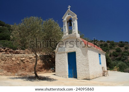 Old chapel, tree and chair - stock photo