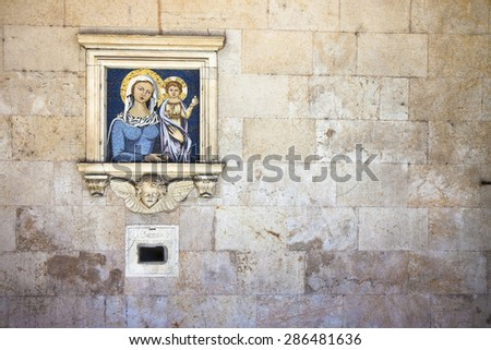 """Old charity box embedded in a stone wall. On the wall you can see the inscription: """"La limosina pi poveri prigioni"""" which means """"The alms for the poor prisoners"""". - stock photo"""