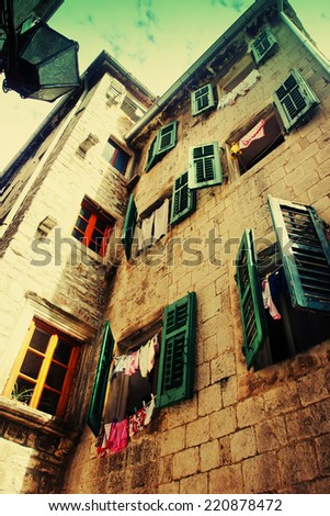 old charming street / A lot of windows with old wood shutters in old Europe town - stock photo