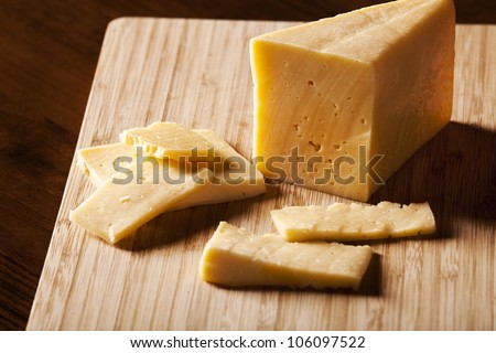 Old cheese cut. - stock photo