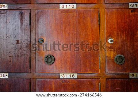 Old cherry wood locker in grungy retro looks. - stock photo