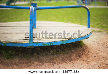 old children carousel, shabby paint - stock photo