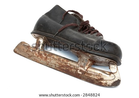 Old children's skates on a white background - stock photo