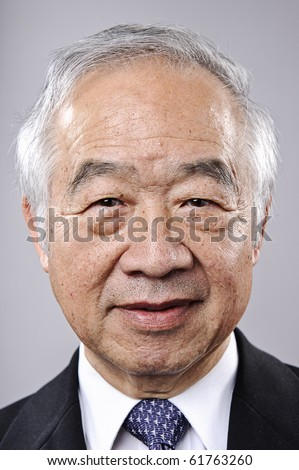 Old Chinese businessman portrait in studio - stock photo