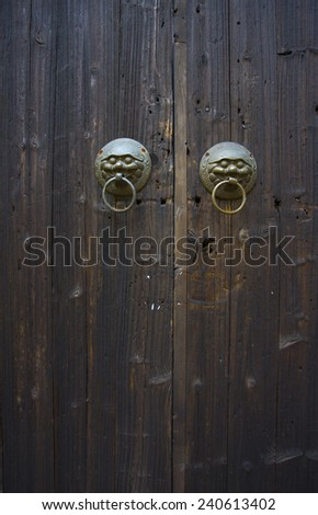 Old Chinese wooden door painted black - stock photo