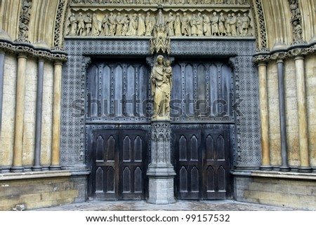 Old Christian church entrance decorated with marble statues