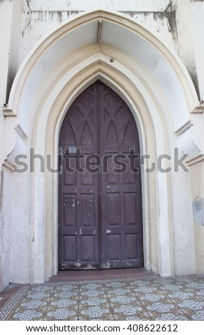 Old church door with arch, vintage