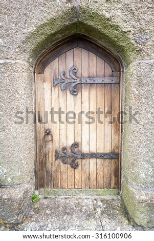 old church door with large hinges