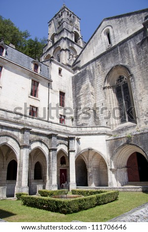 Old church of brantome with little fountain in the garden - stock photo