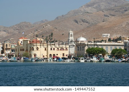 Old Church of Kalymnos and Fishing Boats - stock photo