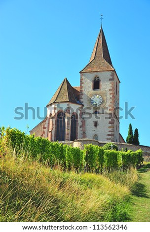 Old church on top of vvineyards at Alsace, France - stock photo