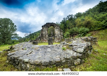 Old church ruins in the mountains under the cloudy sky