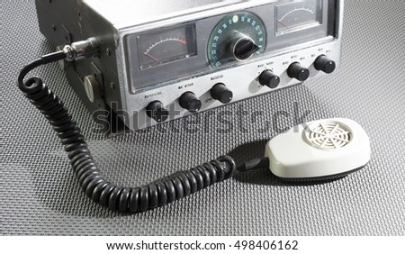 Old citizens band radio with a microphone on a rubber mat