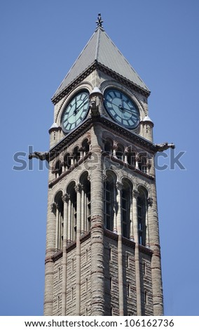 Old City Hall Tower in Toronto, Canada. A day view of the tower and clock - stock photo
