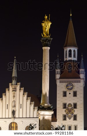 Old city hall with statue of Saint Mary in Munich, Germany, at night - stock photo