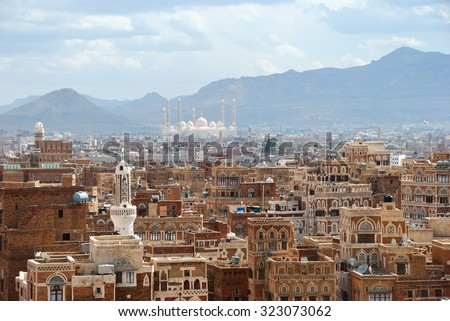 Old city of Sanaa the capital of Yemen. View on the city from roof at sunrise - stock photo