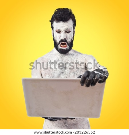 Old civilisation man with laptop over colorful background - stock photo