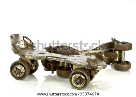 Old clamp-on roller skates on white - stock photo