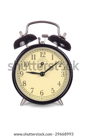 Old, classic alarm clock isolated on white background