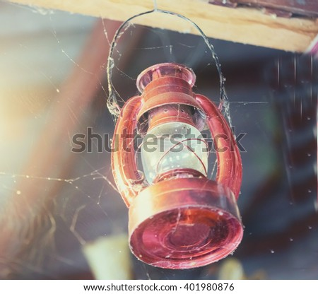 Old classic dusty oil lamp - stock photo