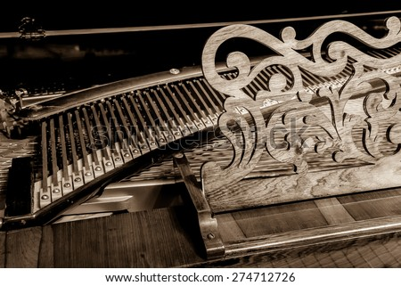 Old Classic Piano with Sepia tone. - stock photo