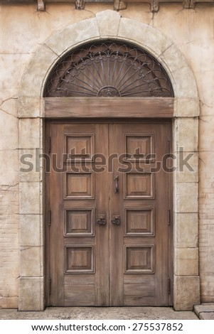 Old classic wooden door in Italy - stock photo
