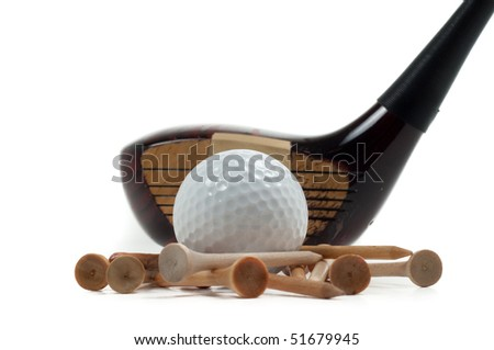 Old, classic wooden driver with white golf ball and wooden tees