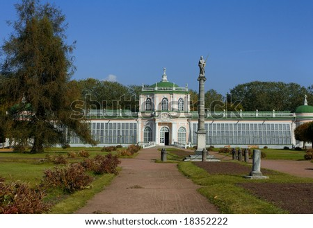 Old classical palace on garden and blue sky background - stock photo