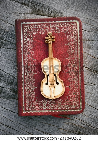 Old classical violin with books - stock photo