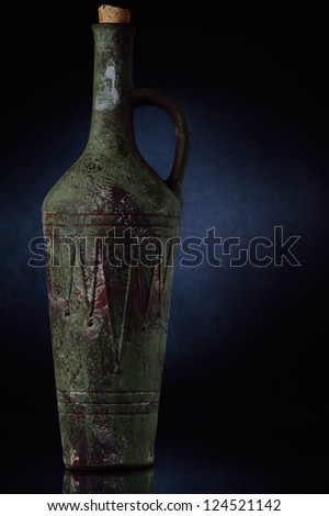 Old clay bottle of wine - stock photo