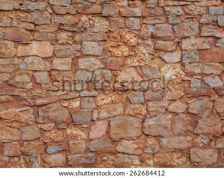 Old clay stone wall background, texture - stock photo