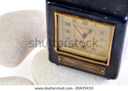 old clock between white stones - stock photo