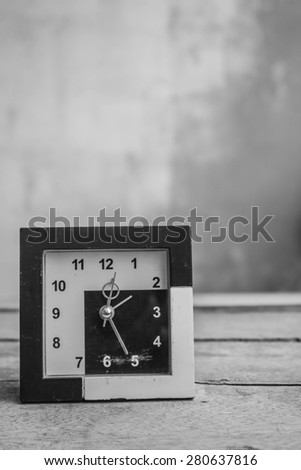 Old clock on a black and white background. - stock photo