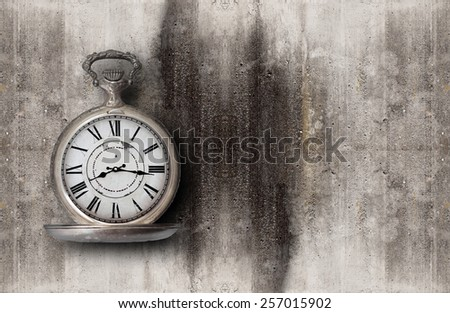 old clock on a concrete background - stock photo