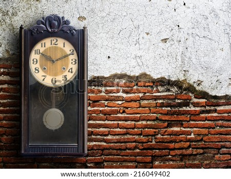 Old clock on grunge wall. - stock photo