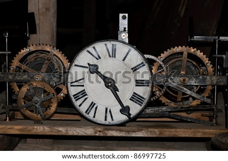 old clock with exposed clockwork - stock photo