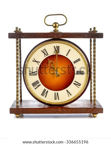 Old clock with roman numerals showing eleven o'clock on white background - stock photo