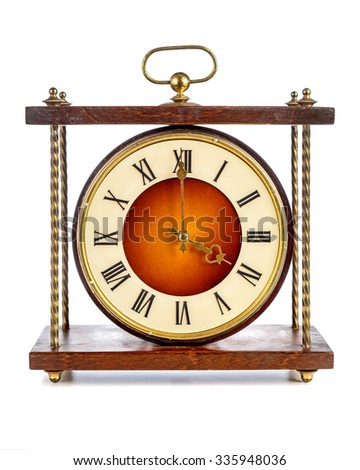 Old clock with roman numerals showing four o'clock over white background - stock photo