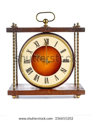 Old clock with roman numerals showing ten o'clock on white background - stock photo