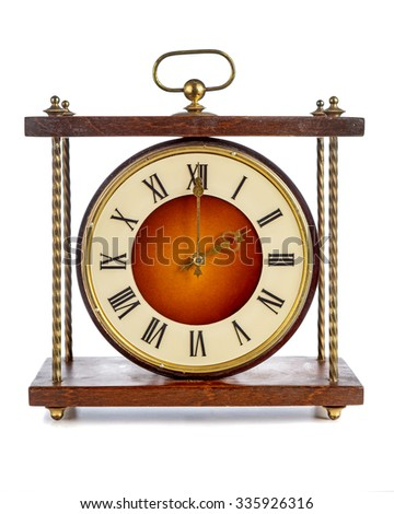 Old clock with roman numerals showing two o'clock over white background - stock photo