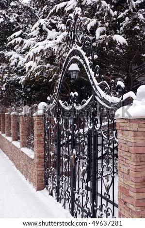 Old Closed gate and fence . Winter . - stock photo