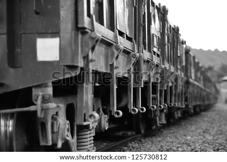 Old coal train car, black and white photo. - stock photo