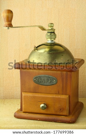 old coffee grinder brown in color - stock photo